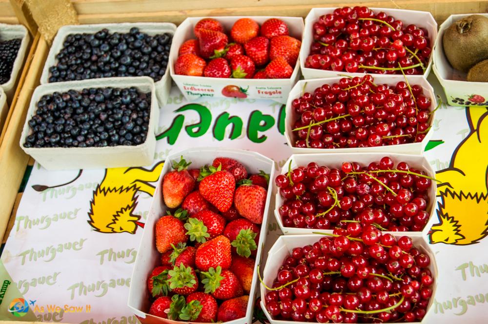 Fresh cherries, strawberries and blueberries in Marktplatz, Basel.