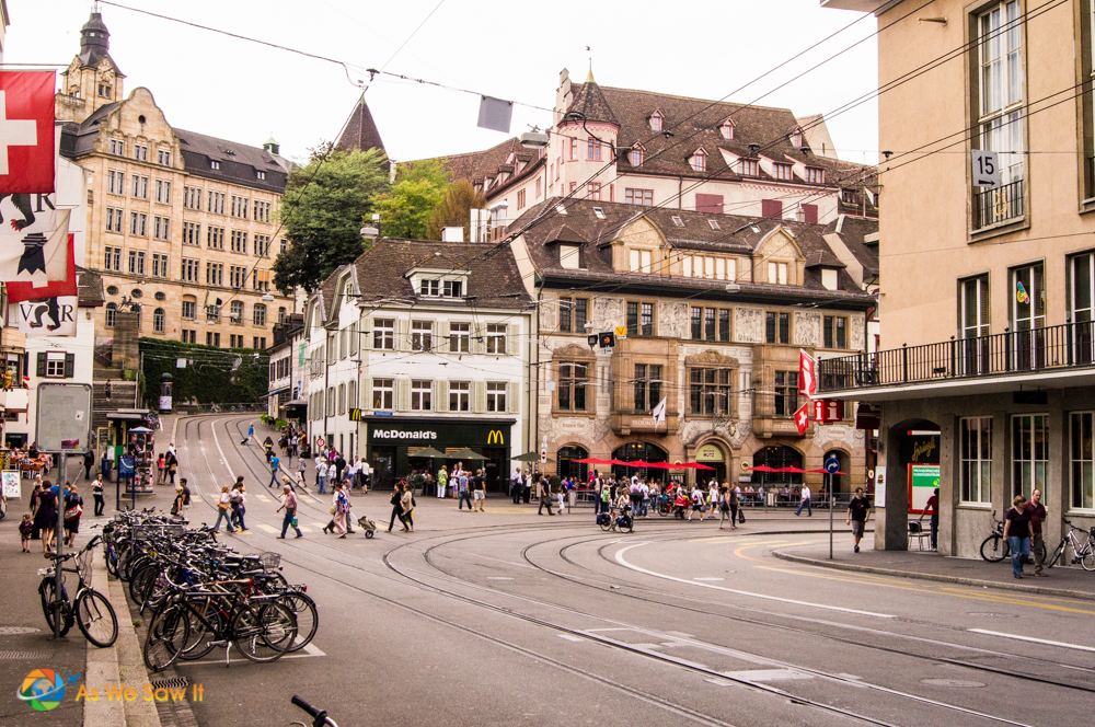 view up a hilly street leading away from the Rhine River in Basel.