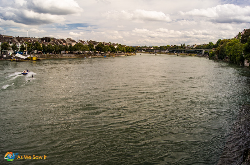 A motorboat pulls water skiier on Rhine river in Basel, Switzerland