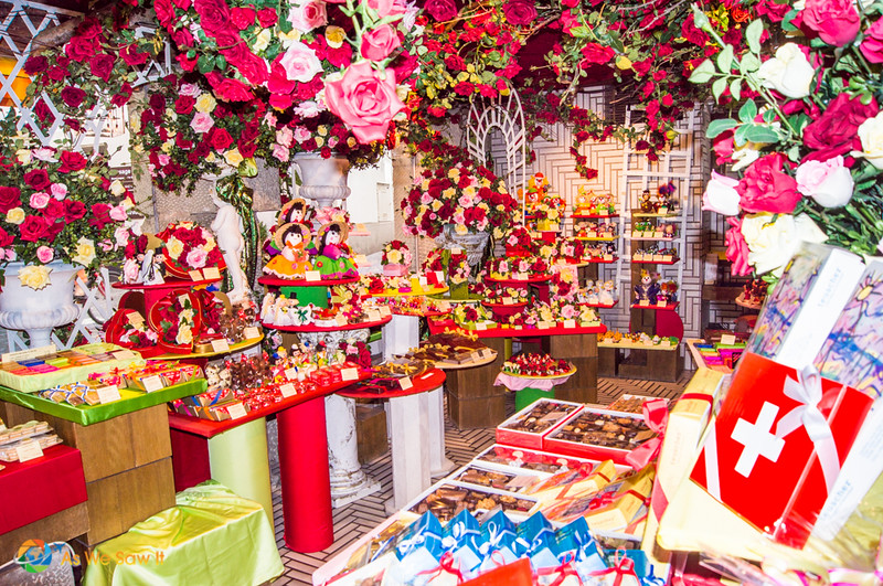 Swiss chocolates are one of the biggest things to do in Zurich Switzerland. This View of the showroom in a colorful candy and flower shop in Zurich.