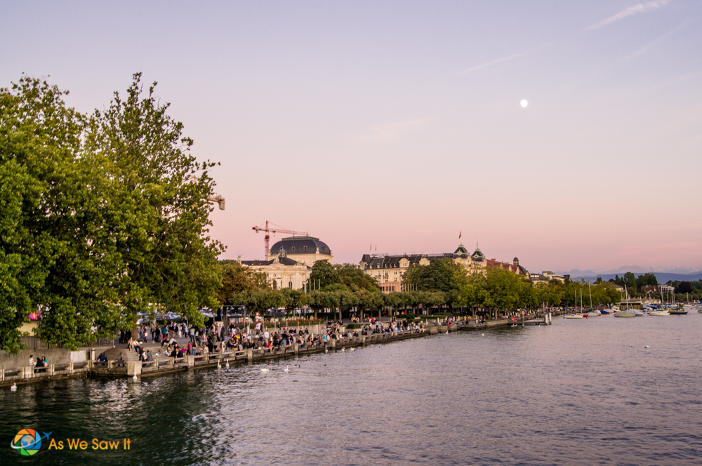 Moon rising over Lake Zurich as the sun sets.
