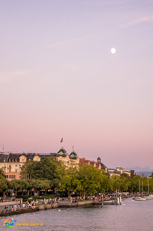 The moon rises as the sun sets, Lake Zurich, Switzerland.