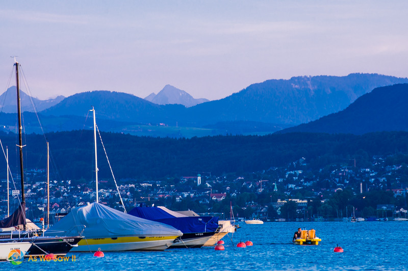 View from Lake Zurich with the Swiss Alps in the background.