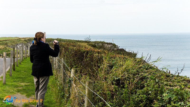 Linda taking videos along the Antrim coast.