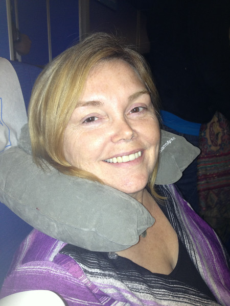 Linda uses inflatable travel pillow while flying