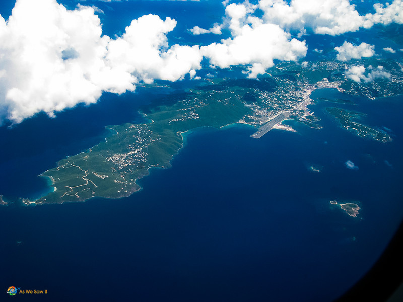 Aerial view of an island. Clouds in upper left.