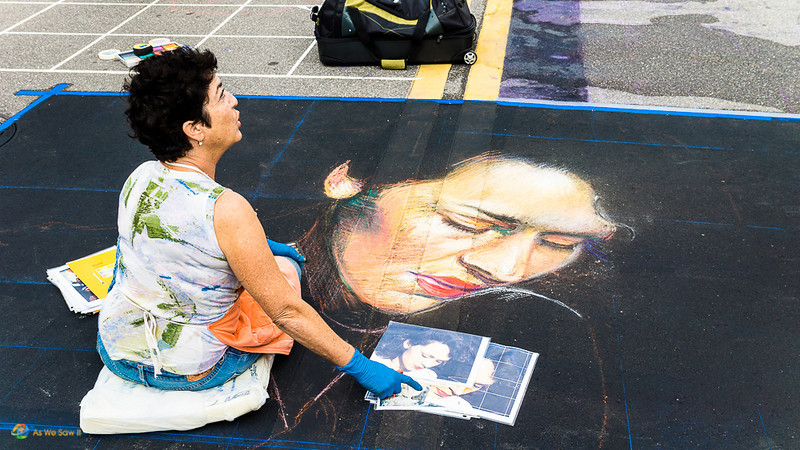 Woman copying a photo at chalk festival