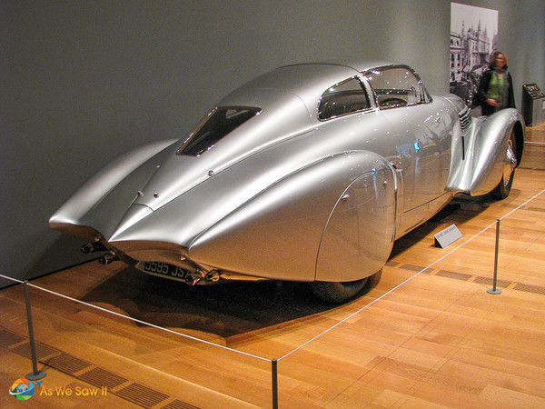 rear view of silver concept car exhibited at The Allure of the Automobile