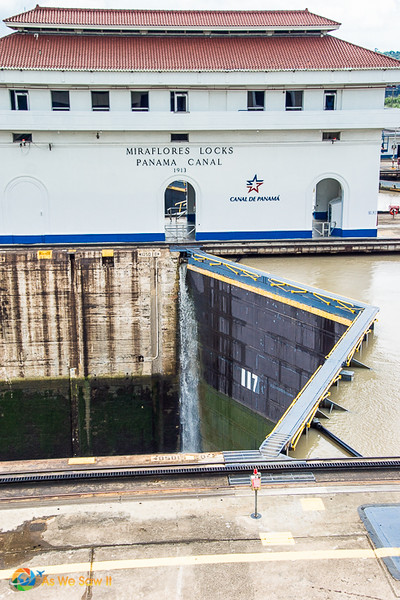 Control building at Panama Canal. Sign on building says Miraflores Locks Panama Canal