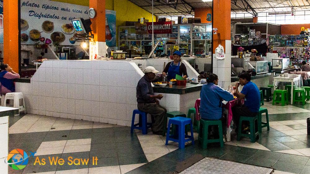 Food stall in Banos mercado, serving local fare