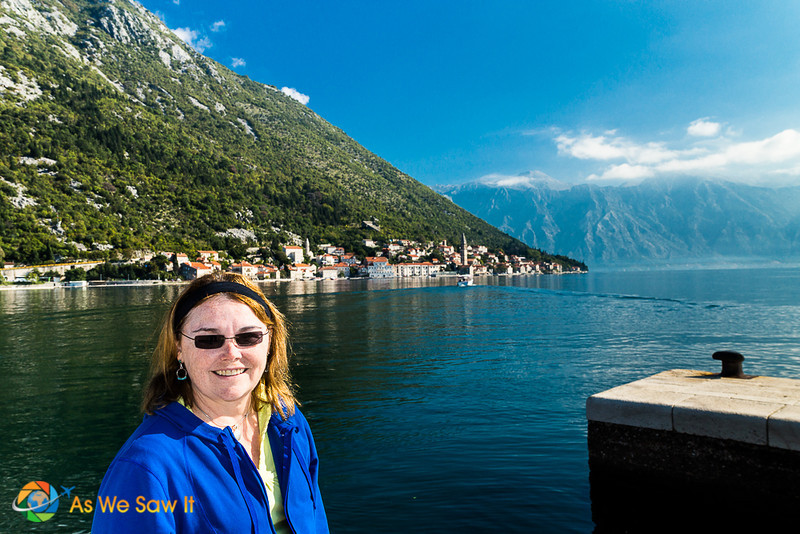 Linda poses for a photo on Our Lady of the Rocks. Bay of Kotor in the background.