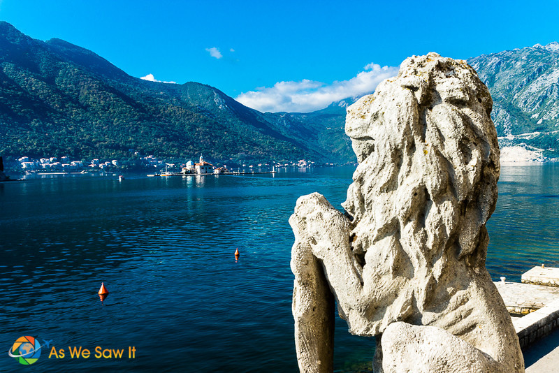 Lion of St. Mark statue holds a coat of arms in one paw, Perast, near Kotor, Montenegro