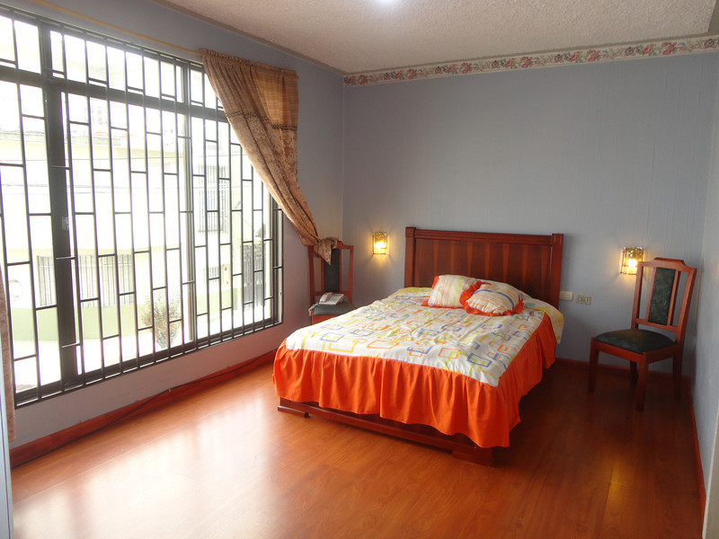 Cuenca apartment bedroom windows and cabinets