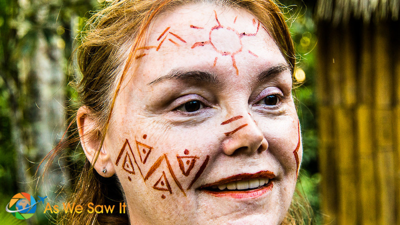 Linda models Amazonian face painting.