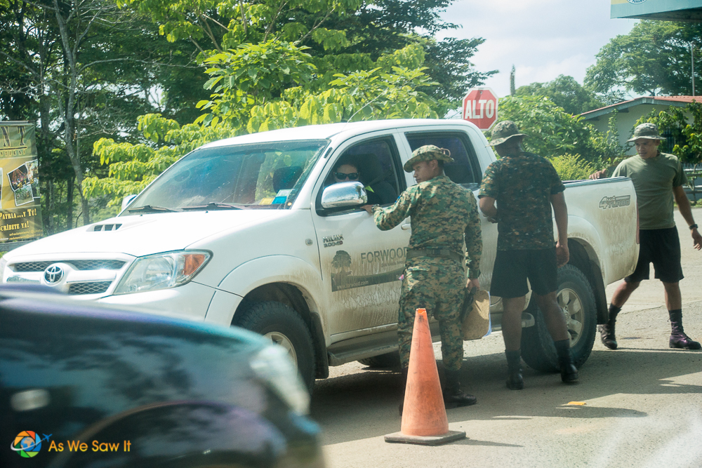 Typical police roadblock in Darien, Panama, checking papers.